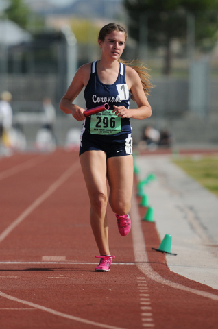 Coronado's Sara Dort finishes first in the girls 3,200-meter relay at the Sunrise Region track meet on Saturday. The Cougars won in 9 minutes, 46.03 seconds. Dort also won the 800, 1600 and 3,200  ...