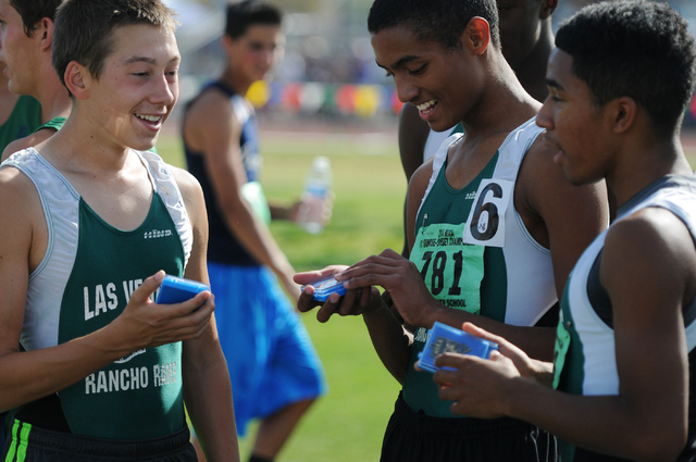 Rancho's 3,200-meter relay boys team Chase Norberg, from left, Lorenzo Johnson and Novell Reid, hold their first-place medals following their race at the Sunrise Region meet on Saturday. The Rams  ...