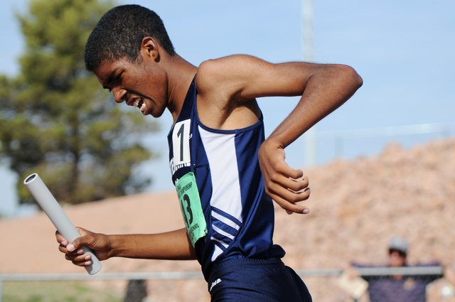 Centennial's Bryan Espino finishes first in the boys 3,200-meter relay at the Sunset Region meet on Saturday. The Bulldogs won the race in 8 minutes, 6.62 seconds. (Erik Verduzco/Las Vegas Review- ...