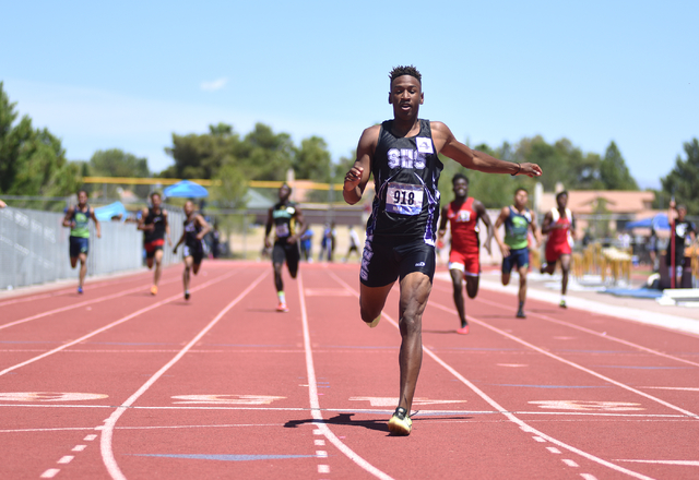 Silverado's Zakee Washington finishes in first place after competing in the boys 400-meter dash at the Sunrise Region meet held at Del Sol High School in Las Vegas on Saturday, May 14, 2016. Marti ...