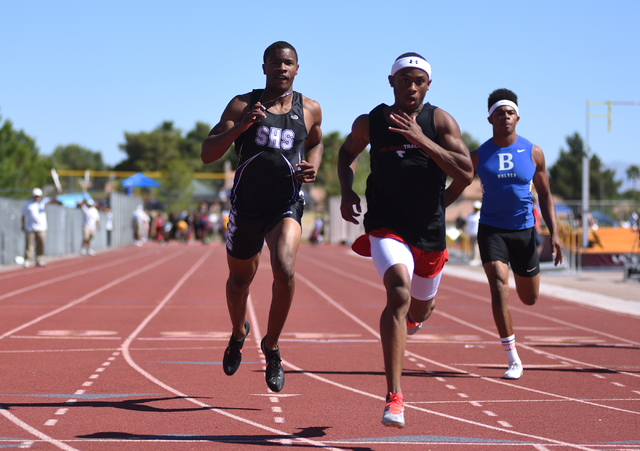 Las Vegas Tre James, center, wins first place in the boys 100-meter dash at the Sunrise Region meet held at Del Sol High School in Las Vegas on Saturday, May 14, 2016. Silverado's Devion Clayton,  ...