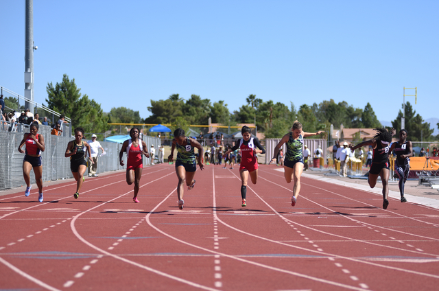 Green Valley's Deborah Grant, fourth from left, wins first place in the 100-meter dash at the Sunrise Region meet held at Del Sol High School in Las Vegas on Saturday, May 14, 2016. Martin S. Fuen ...