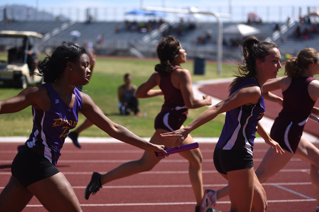 Durango's Jamilah Rich-Manard, left, hands off the baton to teammate Zarina Felix during the girls 800-meter relay at the Sunset Region meet held at Del Sol High School in Las Vegas on Saturday, M ...