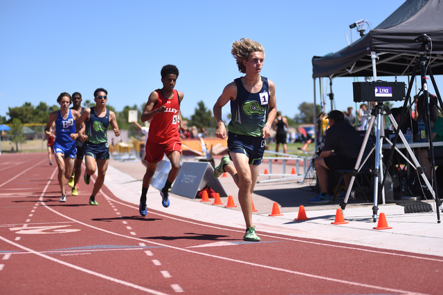 Green Valley's Austin Rogers, right, leads in the 1,600-meter run at the Sunrise Region meet held at Del Sol High School in Las Vegas on Saturday, May 14, 2016. Behind Rogers is Valley's Abel Tesf ...