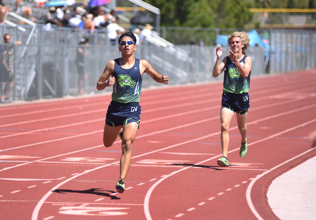 Green Valley's Lenny Rubi, left, wins the 1,600-meter run at the Sunrise Region meet held at Del Sol High School in Las Vegas on Saturday, May 14, 2016. Martin S. Fuentes/Las Vegas Review-Journal