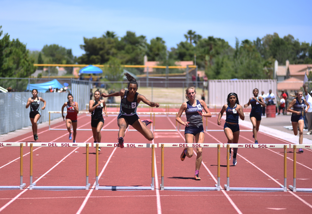 Palo Verde's Jessica Fields, center, jumps over a hurdle during the 300-meter hurdles at the Sunset Region meet held at Del Sol High School in Las Vegas on Saturday, May 14, 2016. Martin S. Fuente ...