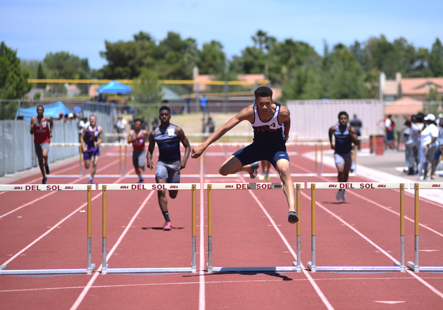Legacy's Jamal Britt, center, jumps over a hurdle during the 300-meter hurdles at the Sunset Region meet held at Del Sol High School in Las Vegas on Saturday, May 14, 2016. Martin S. Fuentes/Las V ...