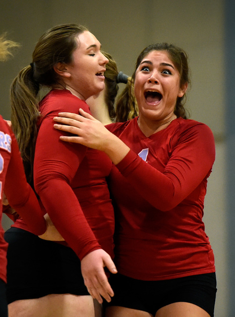 Western's Elaina Tillmond, right, and Nikki Riggs react after scoring a point against Pahrump Valley during a high school volleyball game at Western High School, Thursday, Oct. 27, 2016, in Las Ve ...