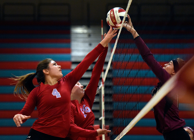 Western's Elaina Tillmond (4) and Adrianna Jones goes for the ball against Pahrump Valley's Bethany Calvert during a high school volleyball game at Western High School, Thursday, Oct. 27, 2016, in ...