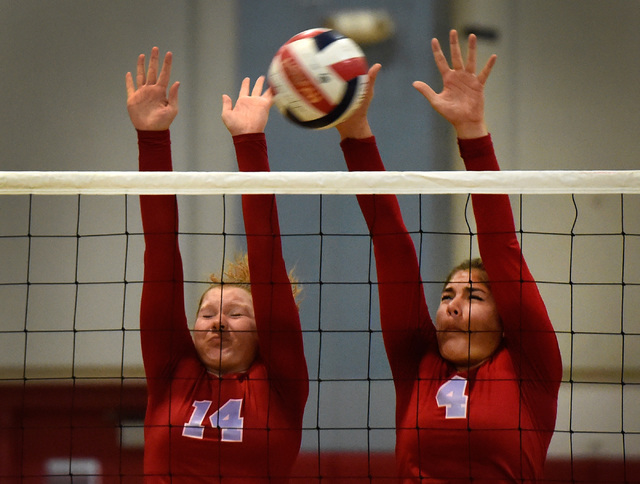 Western's Camille Riggs (14) and Elaina Tillmond block the ball against Pahrump Valley during a high school volleyball game at Western High School, Thursday, Oct. 27, 2016, in Las Vegas. Pahrump V ...