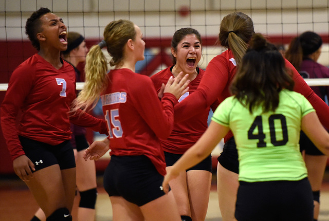 Western players from left, Jannessa Dunton, Adrianna Jones, Elaina Tillmond, Nikki Riggs and Crystal Gallaga reacts after scoring a point against Pahrump Valley during a high school volleyball gam ...