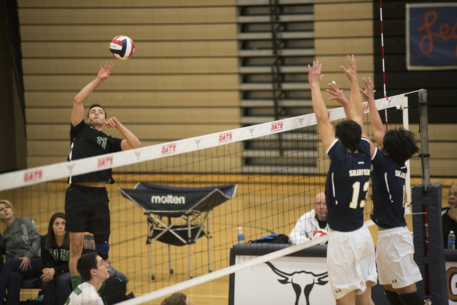 Palo Verde's Michael Simister (11) goes up to spike the ball against Shadow Ridge during their Sunset Regional volleyball semifinal match held at Legacy High School's gym in North Las Vegas on Thu ...