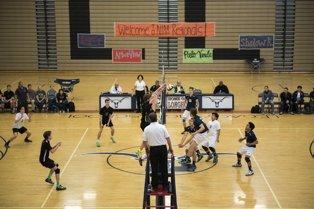 Palo Verde, left, plays against Shadow Ridge during their Sunset Regional volleyball semifinal match held at Legacy High School's gym in North Las Vegas on Thursday, May 7, 2015. Palo Verde won 3- ...