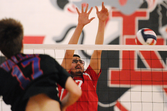 Valley's Jack Heavey (17) spikes the ball over Las Vegas' Guillermo Gonzalez (7) during the Sunrise Region boys volleyball championship match on Friday. Heavey had 33 kills and seven digs, but Las ...