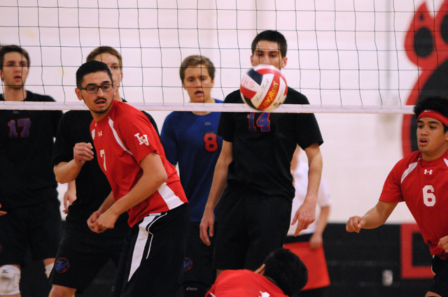 Las Vegas' Guillermo Gonzales (7) and Shayne Marquez (6) watch as Brian Singson (1) saves the ball during the Sunrise Region boys volleyball championship match on Friday. Singson had 16 digs as La ...
