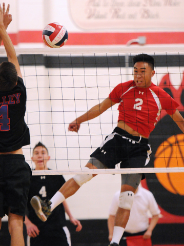 Las Vegas' T.J. Esporas (2) spikes the ball over Valley's Alex Sandoval (4) during the Sunrise Region boys volleyball championship match on Friday. Esporas had 15 kills as Las Vegas won, 3-2. (Eri ...