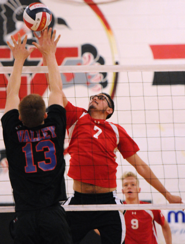 Las Vegas' Guillermo Gonzales (7) spikes the ball over Valley's Zack Ross (13) during the Sunrise Region boys volleyball championship match on Friday against Valley. Las Vegas won, 3-2. (Erik Verd ...