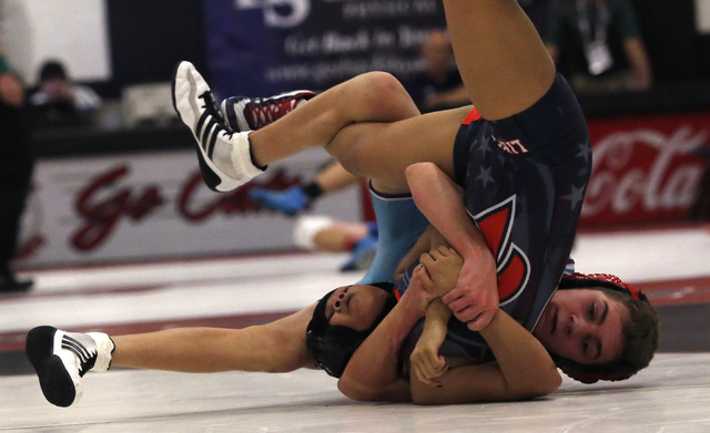 Silverado's Nick Reyes, blue singlet, looks for a pin against Liberty's Mikaylah Mangundayao during a 106 pounder match at the Sunrise Region wrestling meet on Friday, Feb. 3, 2017, in Las Vegas.  ...