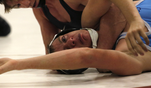 Green Valley's Wallace Zernich, top, wrestles Foothill's Steven Lopez during a 145 pounder match at the Sunrise Region wrestling meet on Friday, Feb. 3, 2017, in Las Vegas. (Christian K. Lee/Las V ...