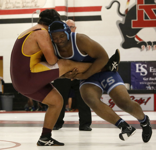 Canyon Spring's Lord Oroke, right, shoots a single against Eldorado's Paul Velarde  during a 220 pounder match at the Sunrise Region wrestling meet on Friday, Feb. 3, 2017, in Las Vegas. (Christia ...