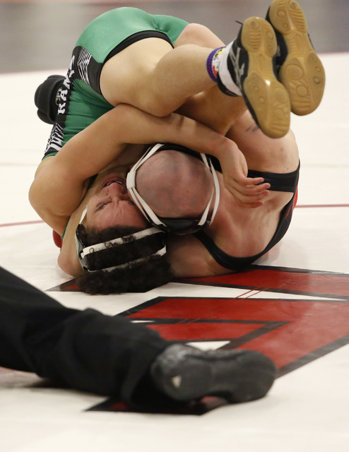 Las Vegas's Daniel Law, right, attempts to pin Eldorado's Isac Rubio during a 132 pounder match at the Sunrise Region wrestling meet on Friday, Feb. 3, 2017, in Las Vegas. (Christian K. Lee/Las Ve ...