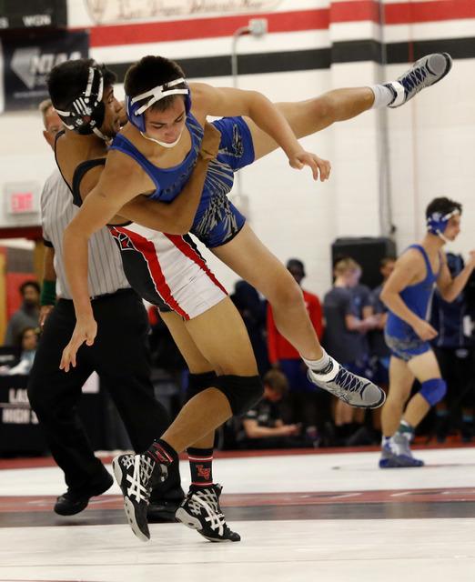 Las Vegas's Aaron Najera lifts Basic's Nick Ortiz during a 138 pounder match at the Sunrise Region wrestling meet on Friday, Feb. 3, 2017, in Las Vegas. (Christian K. Lee/Las Vegas Review-Journal) ...