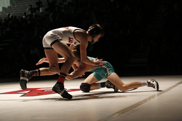Las Vegas's Nathan Rhoads, left, sprawls as Green Valley's Will Zernich shoots a single during a 113 pounder match at the Sunrise Region wrestling meet on Saturday, Feb. 4, 2017, in Las Vegas. (Ch ...