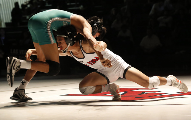 Green Valley's David Kalayanaprapruit, left, sprawls as Las Vegas's Antonio Saldate shoots a single during a 120 pounder match at the Sunrise Region wrestling meet on Saturday, Feb. 4, 2017, in La ...