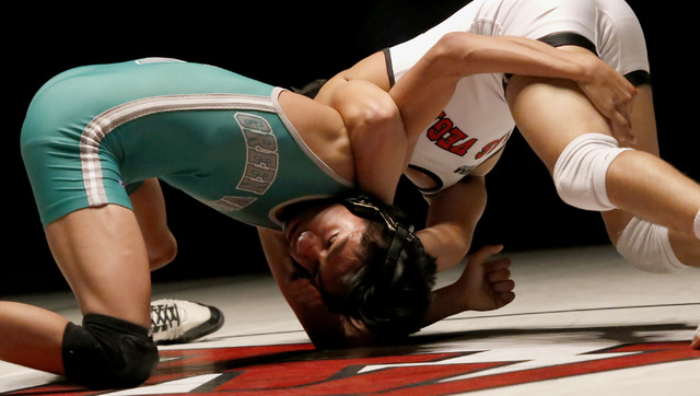 Las Vegas's Antonio Saldate, right, cranks a half nelson against Green Valley's David Kalayanaprapruit during a 120 pounder match at the Sunrise Region wrestling meet on Saturday, Feb. 4, 2017, in ...