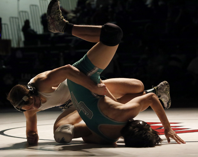 Foothill's Wyatt English, left, wrestles Green Valley's Desmond Bowers during a 138 pounder match at the Sunrise Region wrestling meet on Saturday, Feb. 4, 2017, in Las Vegas. (Christian K. Lee/La ...
