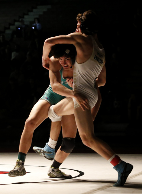 Green Valley's Desmond Bowers, left, shoots on Foothill's Wyatt English during a 138 pounder match at the Sunrise Region wrestling meet on Saturday, Feb. 4, 2017, in Las Vegas. (Christian K. Lee/L ...