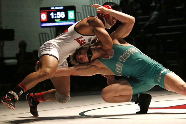 Las Vegas's Jaesen Caday, left, sprawls as Green Valley's Wallace Zernich shoots a single during a 145 pounder match at the Sunrise Region wrestling meet on Saturday, Feb. 4, 2017, in Las Vegas. ( ...