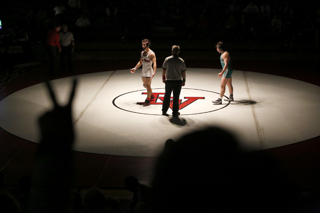 A fan signals to a referee to award Green Valley's Cody Chamblerlin, right, two points during an overtime 152 pounder match at the Sunrise Region wrestling meet on Saturday, Feb. 4, 2017, in Las V ...
