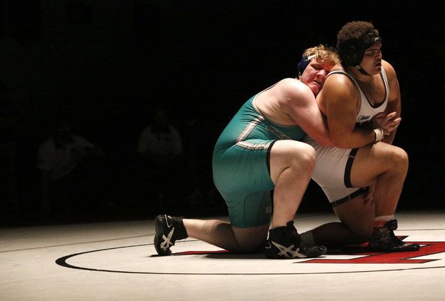 Green Valley's Anthony Valenti, green singlet, wrestles Las Vegas's Robert Keampfer during a 285 pounder match at the Sunrise Region wrestling meet on Saturday, Feb. 4, 2017, in Las Vegas. (Christ ...