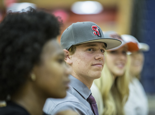 Bishop Gorman baseball player Jarrod Billig sits with fellow student athletes expected to sign college letters of intent during the fall on Wednesday, Nov. 9, 2016, at Bishop Gorman High School, i ...