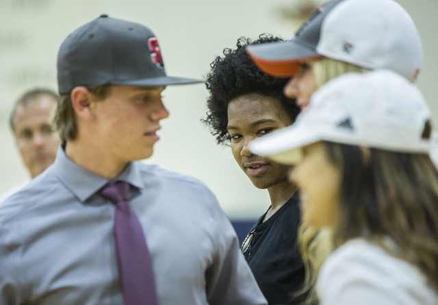 Bishop Gorman's Skylar Jackson, middle, talks with fellow student athletes expected to sign college letters of intent during the fall on Wednesday, Nov. 9, 2016, at Bishop Gorman High School, in L ...