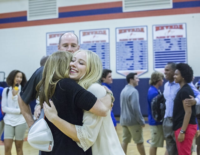 Bishop Gorman's Abbey Archambault hugs her mother Nancy Archambault during an event for student athletes expected to sign college letters of intent this fall on Wednesday, Nov. 9, 2016, at Bishop  ...