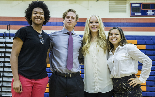 Bishop Gorman athletes Skylar Jackson, left, Jarrod Billig, Abbey Archambault and Leah Glaser pose for a photo during an event for students expected to sign college letters of intent during the fa ...