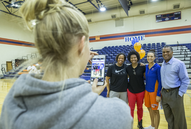 Sherry Washington, Skylar Jackson, Teena Baxter and Kevin Hixon pose for a photo during an event for Bishop Gorman athletes expected to sign college letters of intent during the fall on Wednesday, ...