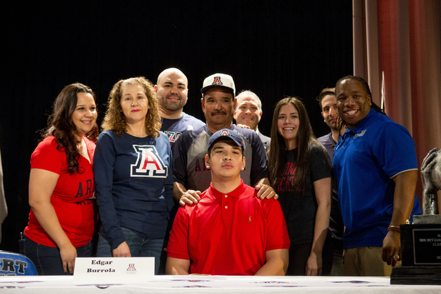 Senior Edgar Burrola poses with his family and friends after signing to play football for University of Arizona at Desert Pines High School, Las Vegas, February. 1, 2017.  (Elizabeth Brumley/Las V ...