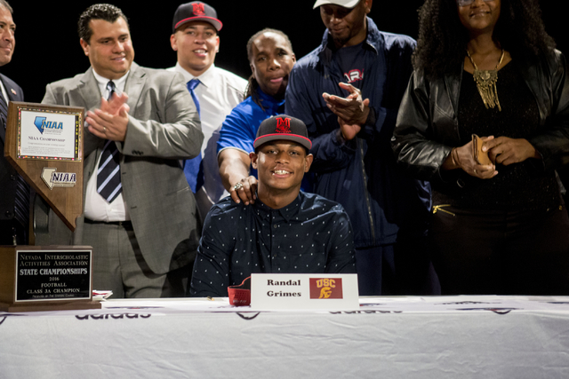 Senior Randal Grimes signs to play college football for University of Southern California at Desert Pines High School, Las Vegas, February. 1, 2017.  (Elizabeth Brumley/Las Vegas Review-Journal) @ ...