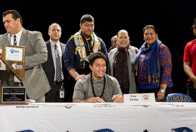 Senior Tito Philip poses after signing to play college football at Western New Mexico University, Desert Pines High School, Las Vegas, February. 1, 2017.  (Elizabeth Brumley/Las Vegas Review-Journ ...