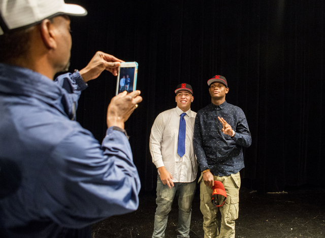 Desert Pines High School Seniors Monquel Galsow, left, and Randal Grimes, take a photo together after signing to play college football, Las Vegas, February. 1, 2017.  (Elizabeth Brumley/Las Vegas  ...
