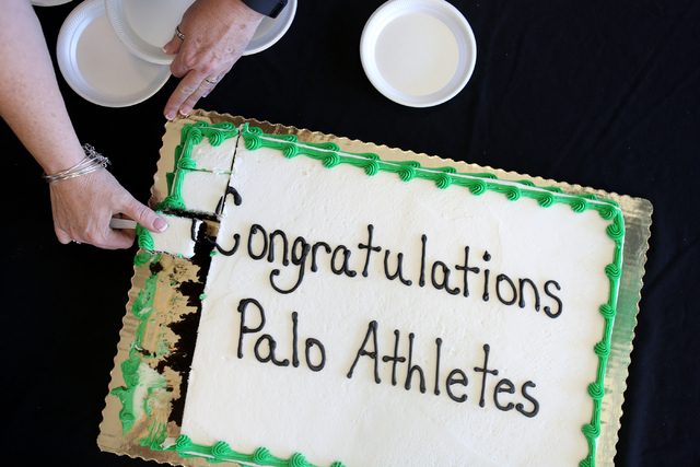 A cake is cut in celebration of the Palo Verde senior athletes that were chosen to play their sport at different universities across the country Wednesday, Nov. 9, 2016, at Palo Verde High School  ...