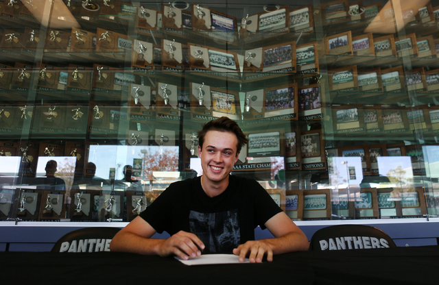 Palo Verde senior Jack Trent signs his paperwork for playing golf at UNLV, Wednesday, Nov. 9, 2016, at Palo Verde High School in Las Vegas. Elizabeth Page Brumley/Las Vegas Review-Journal Follow @ ...