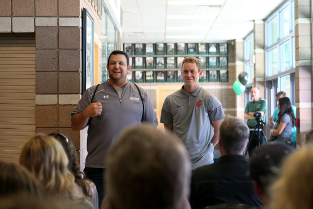 Palo Verde senior Dylan Orlando coach is celebrated by his baseball coach Joe Hallead at Palo Verde High School before signing onto play baseball for Washington State University, Wednesday, Nov. 9 ...
