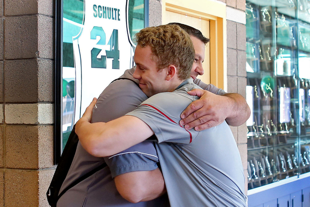Palo Verde senior Dylan Orlando hugs his baseball coach Joe Hallead at Palo Verde High School before signing onto play baseball for Washington State University, Wednesday, Nov. 9, 2016, in Las Veg ...