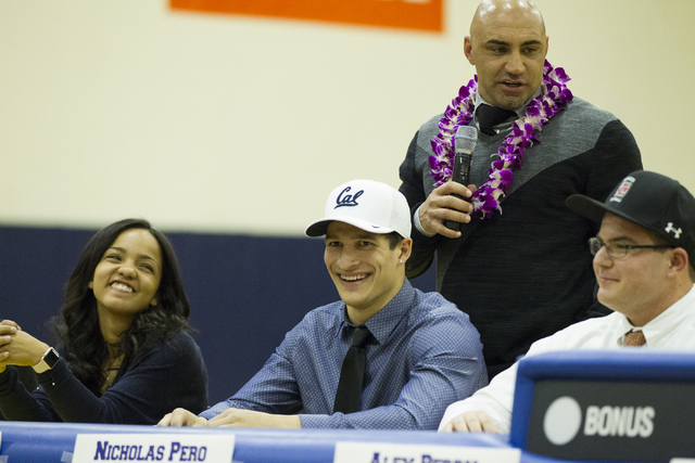 Biaggio Ali Walsh, center, who committed to attending University of California, Berkeley, during Signing Day at Bishop Gorman High School on Wednesday, Feb. 1, 2017, in Las Vegas. (Erik Verduzco/L ...