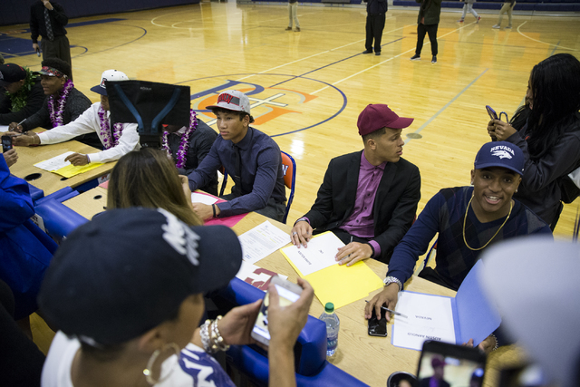 Bishop Gorman athletes are photographed by friends and family during Signing Day at Bishop Gorman High School on Wednesday, Feb. 1, 2017, in Las Vegas. (Erik Verduzco/Las Vegas Review-Journal) @Er ...