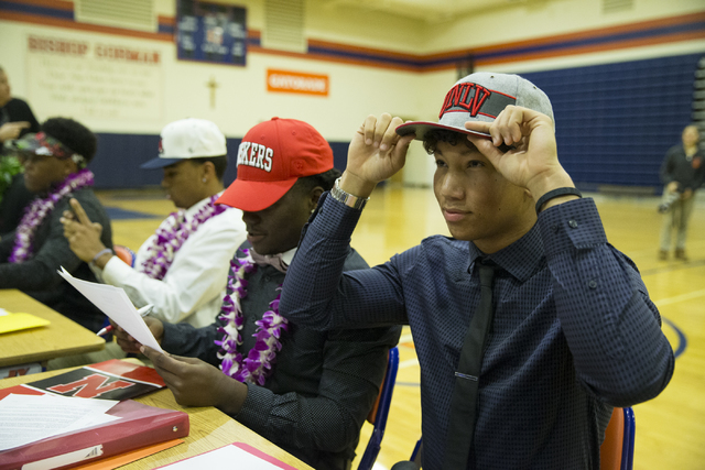 Bishop Gorman's Greg Francis, right, who committed to attending UNLV during Signing Day at Bishop Gorman High School on Wednesday, Feb. 1, 2017, in Las Vegas. (Erik Verduzco/Las Vegas Review-Journ ...
